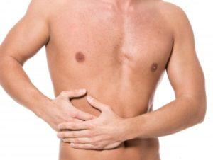 Болит внизу живота справа у мужчин, причины тянущей боли в боку внизу